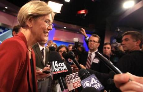 Warren addressed the media after the debate.