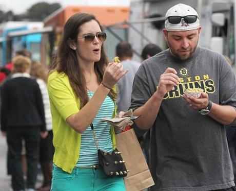 East Boston, MA 092212 Danielle and Nick Masciarelli (cq) of South Boston munched on fried cauliflower during The Suffolk Downs Food Truck Festival in East Boston, Saturday, September 22 2012. (Globe Staff Photo/Wendy Maeda) section: business slug: 30foodtrucks reporter: Jenn Abelson
