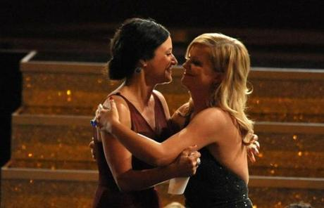Amy Poehler congratulated Julia Louis-Dreyfus as she walked onstage to accept the award for outstanding lead actress in a comedy series for