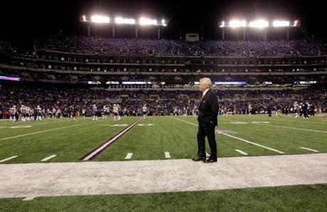 New England Patriots team owner Robert Kraft stands on the sideline at M&T Bank Stadium before the game.