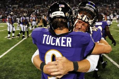 Justin Tucker celebrated with long snapper Morgan Cox.