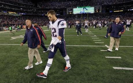 A dejected Tom Brady walked off the field after losing.
