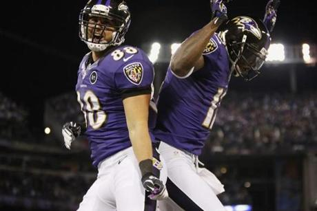Baltimore Ravens tight end Dennis Pitta (left) celebrated his first-half touchdown against the Patriots with teammate Tommy Streeter.