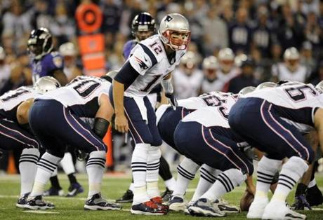 Patriots quarterback Tom Brady  prepared to run a play in the first half.