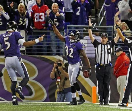 Torrey Smith celebrated after he hauled the fourth quarter touchdown pass from Joe Flacco.