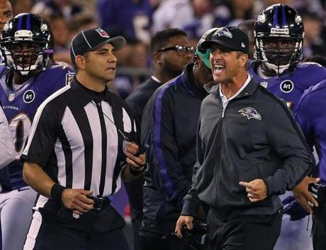 Ravens head coach John Harbaugh screamed at an official after a first half play.