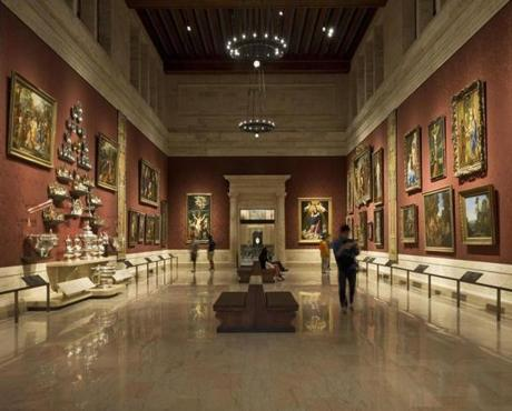 The William I. Koch Gallery at the Museum of Fine Arts Boston was renovated and rehung this summer. The room now has red damask covering the formerly bare marble walls, rail guards to protect the art, a new display of silver pieces, and a reorganization of the paintings. The room now seems