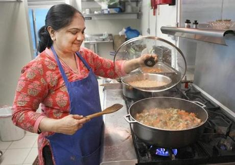 Sailaja Maddali looks after a stew at Mommy's Home Kitchen in Shrewsbury. Her catering business became so popular that she had to move it from her home to a retail location.
