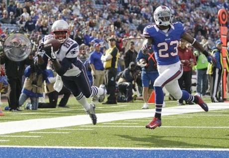 Patriots receiver Brandon Lloyd  made a touchdown catch next to Aaron Williams  during the second half .