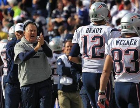 Patriots coach Bill Belichick applauded after Tom Brady's touchdown pass to Brandon Lloyd in the fourth quarter.