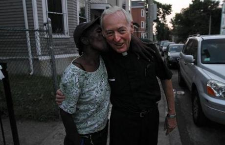 Anette Haynes gives Conway a kiss on Richfield Street while he  walked the neighborhood on a Friday night in August.