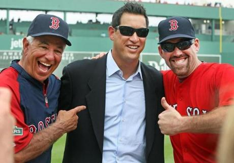 Valentine and Kevin Youkilis, right, seemed to get off to a good start when they joked around with Red Sox executive vice president/business affairs Jonathan Gilula on Feb. 25.
