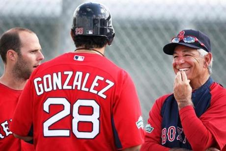 Valentine chatted with Dustin Pedroia (left) and Adrian Gonzalez on Feb. 27.
