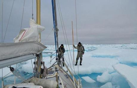 Morgan Peissel, Nicolas Peissel, and Edvin Buregren stood on the ice in the McClure Strait in front of their sailboat, the Belzebub II.