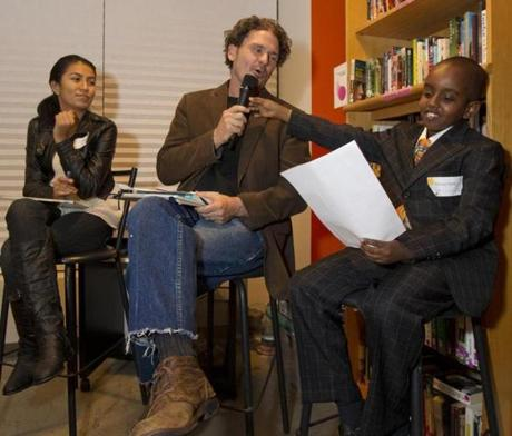 Roxbury MA 10/4/12 (l to r) Dulce Berna (cq), 11, Dave Eggers (cq) and Wajaah Farah (cq), 9, with the audience helping write a childrens book called,
