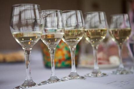 A flight of five white wines were ready for tasting.