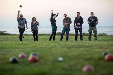 The evening game of bocce was played right next to the water.