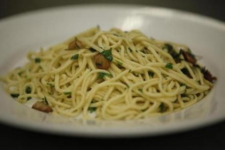 Spaghetti with fresh herbs, garlic and lemon zest.