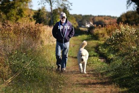 Along the Bay Farm Conservation Area, Lou Noselli from Plymouth walked with his dog Jackson.