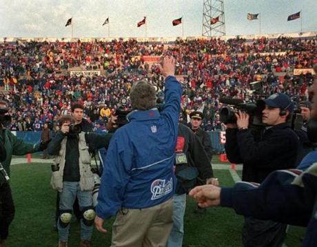 Carroll saluted the Foxboro Stadium fans after winning the finale of the 1999 season. That brought the Patriots back to .500 at 8-8, but still left them on the outside of the playoff field.
