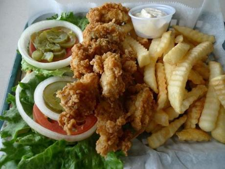 A small order of fried oysters comes with fries and salad vegetables at Papa Joe's Oyster Bar & Grill.
