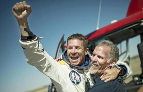 Pilot Felix Baumgartner of Austria celebrated with the project's technical director, Art Thompson, after the mission.