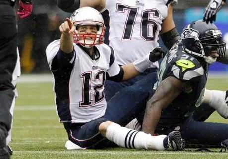 Patriots quarterback Tom Brady pointed to an official after being called for intentionally grounding the ball  in the second half.