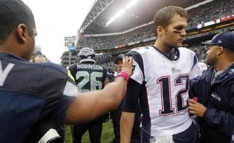 Patriots quarterback Tom Brady  was greeted by Seahawks quarterback Russell Wilson after the game.