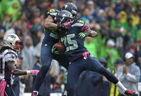 Seattle cornerback Richard Sherman celebrated after intercepting a pass  in the third quarter.
