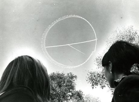 October 15, 1969: A small skywriting plane draws the peace symbol in the clear blue sky over the Boston Common. Two others planes not shown here were alternately towing