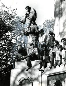 October 15, 1969: The Civil War monument, Soldiers' and Sailors', dedicated on September 17, 1877 provides a vantage point for several onlookers to watch the Moratorium Day crowd.