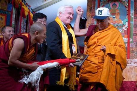 The Dalai Lama received a baseball cap and a key to the city of Medford from Mayor Michael J. McGlynn at the Kurukulla Center for Buddhist Studies Tuesday.