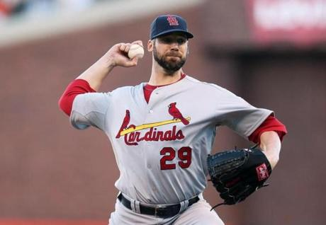 Cardinal pitcher Chris Carpenter lost to Giant pitcher Ryan Vogelsong in Game 2 of the NLCS. Last year, he went 4-0 in the postseason.