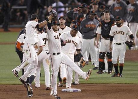 San Francisco Giants' Angel Pagan, left, celebrates with Brandon Crawford after the Giants won.