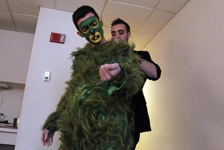 The Grinch costume is a $15,000 handmade suit padded in the stomach and hips.