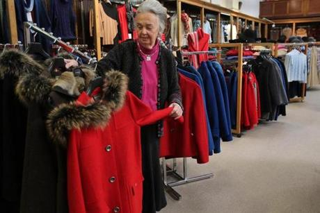 Jean Ritchie adjusts a coat display at E.A. Davis.