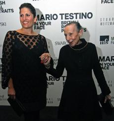 MFA Deputy Director Katie Getchell (left) and Estrellita Karsh, MFA donor and widow of photographer Yousuf Karsh, at the Mario Testino exhibit opening.