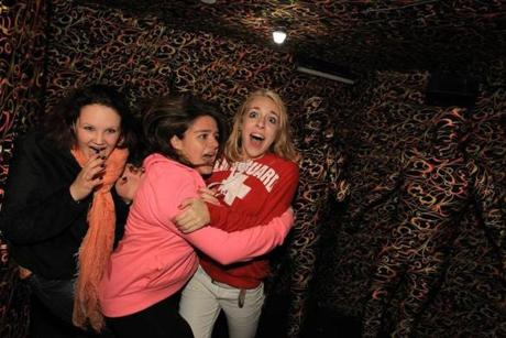 Abington, MA - 10/19/12 - Visitors to Barrett's Haunted Mansion in Abington react as they enter the mansions camo room. - (Globe Staff Photo / Barry Chin), section: South Week, reporter: Andrew Tran, slug: BDC-Barretts-Haunted-Mansion-Reactions, LOID: 5.0.3329642622.