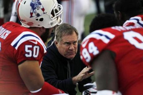 Patriots coach Bill Belichick instructed his defense on the sidelines during the first half.