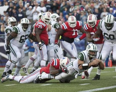 Tim Tebow didn't see much action for the Jets, but nearly found his way into the end zone on this first-quarter run.