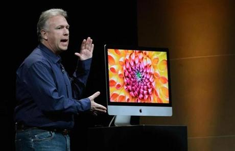 Schiller also unveiled new iMac computers, which have super-thin display screens.