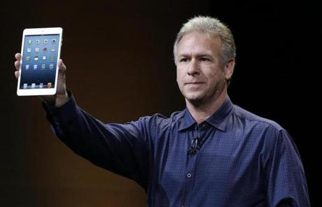 Phil Schiller, Apple's senior vice president of worldwide product marketing, held up the iPad mini.
