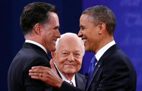 The candidates greeted each other before the event as moderator Bob Schieffer looked on.