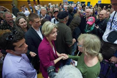 Elizabeth Warren greeted a supporter during a rally at Smith Vocational and Agricultural High School in Northampton.