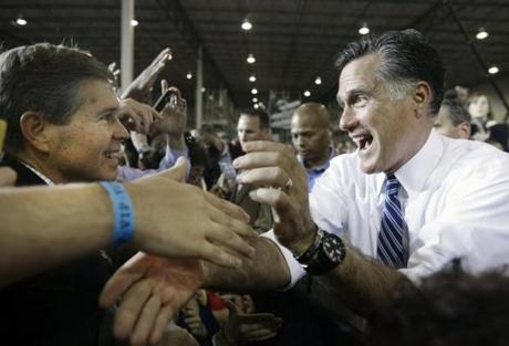 Republican challenger Mitt Romney worked the crowd at an Ohio plant.