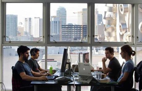 Ben Mathes, Kyan Pardiwalla, Kevin Montag, and Joshua Slayton at work in the AngelList office last week.