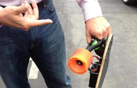 A pedestrian stopped to show off his electric motor-powered Boosted Board.