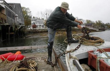 Dirt Murray secured his houseboat in preparation for Hurricane Sandy in Gloucester on Sunday.