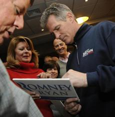 Scott Brown and his wife, Gail Huff, stopped in Lowell.
