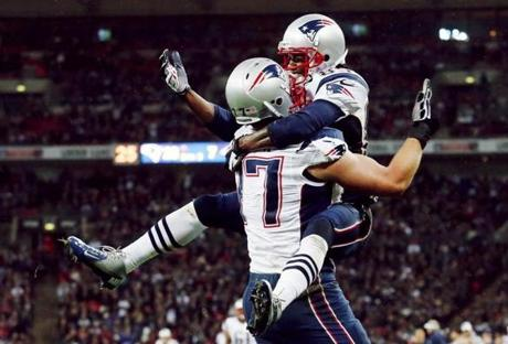 Patriots receiver Brandon Lloyd, right, celebrated his touchdown with lineman Nate Solder during the third quarter.